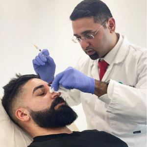 dr aesthetica performing non surgical rhinoplasty